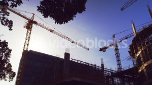 Time lapse of crane and building construction site