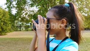 Girl clicking a photograph from camera