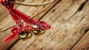 Jingle bells hanging on a branch