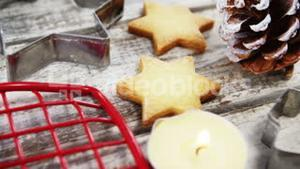 Christmas cookies and cookie cutters with tealight candles