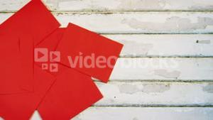 Red envelopes on wooden plank