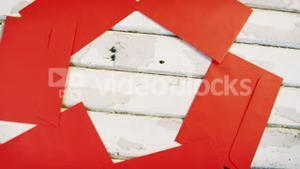 Red envelopes decorated on wooden plank