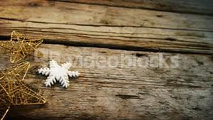 Star and snowflake on wooden plank