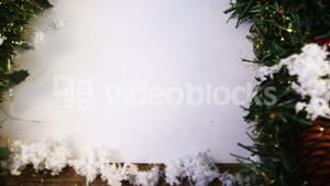 Christmas decoration with fake snow on wooden plank