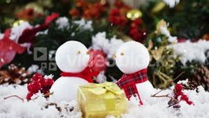 Two snowman with fake snow