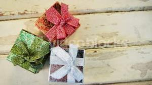 Wrapped gifts on wooden plank