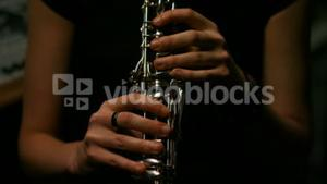 Woman playing a clarinet