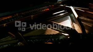 Piano being played in music studio