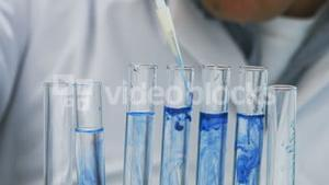 Scientist doing chemical experiment