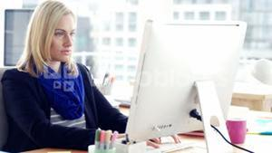 Portrait of businesswoman using computer