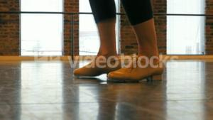 Woman practicing a tap dance
