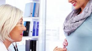 Pregnant woman consulting a female doctor