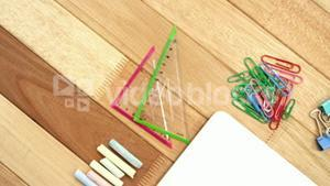 Chalk, set square and paper clip with laptop