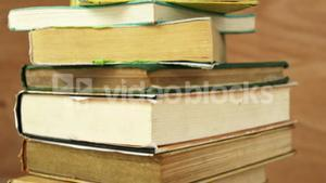 Stack of various books on a desk