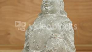 Close-up of crystal laughing buddha