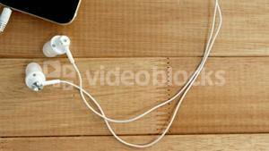 Close-up of mobile phone with headphones