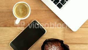 Cup of coffee with laptop and mobile phone
