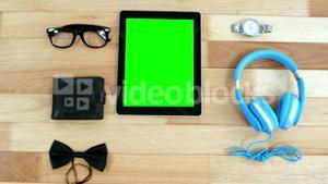 Digital tablet, headphones, wallet, spectacles, wrist watch and bowtie
