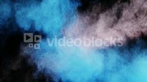 Blue and white dust powder blowing against black background