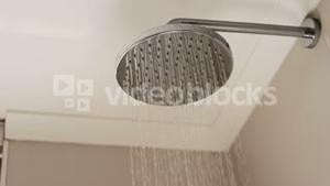 Close-up of shower head with flowing water
