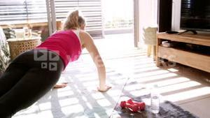 Woman doing exercise in living room