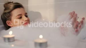 Woman taking bath in bathtub