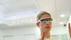 Woman using 3d video glasses in optical clinic