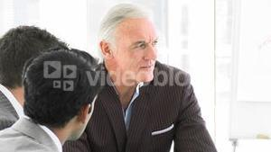 Senior manager talking to his team in a meeting