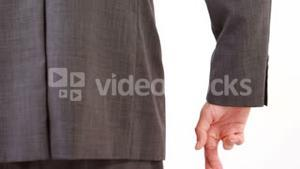 Man standing with finger crossed against white background