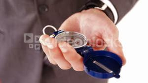 Businessman holding direction compass