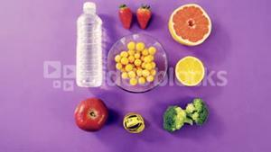 Water bottle, fruits, vegetable and measuring tape