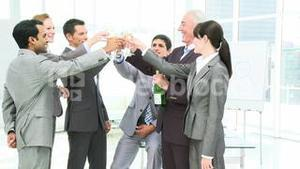 Business team celebrating a success in business with champagne