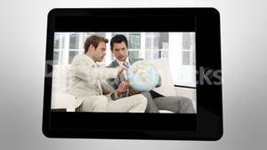 Animated tablet computer showing global companies