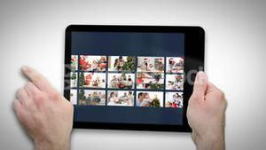Animated tablet computer displaying videos about family at home