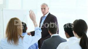 Busineswoman asking a question in a meeting