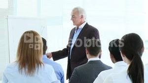 Busineswoman asking a question in a presentation