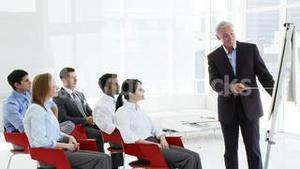 Business people applauding their manager