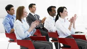Business people applauding in a seminar
