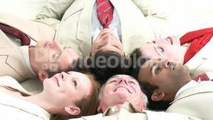 Business team relaxing on floor in a circle