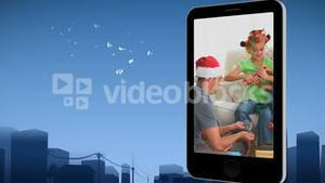 Smartphone showing a family celebrating Christmas