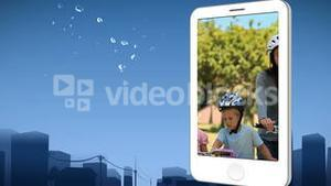 Smartphone showing a family riding bikes
