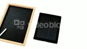 Digital tablet and slate on white background