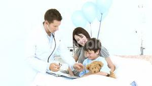 Doctor listening with a stethoscope to a teddy bear