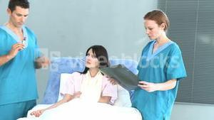 Doctor giving an injection to a patient in bed