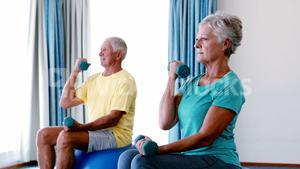 Senior citizens exercising with dumbbells