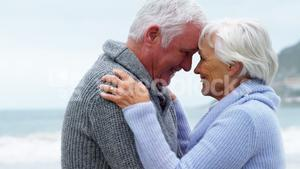 Happy senior couple embracing face to face
