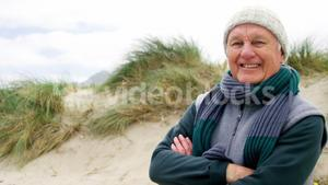 Senior man in sweater feeling cold