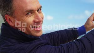 Mature man taking picture of view from mobile phone