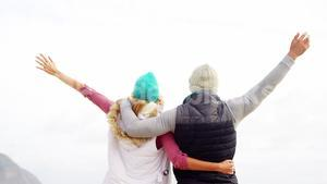 Couple standing with arms outstretched