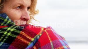 Thoughtful mature woman in shawl feeling cold